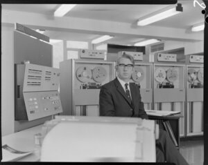 Portrait of man with computers