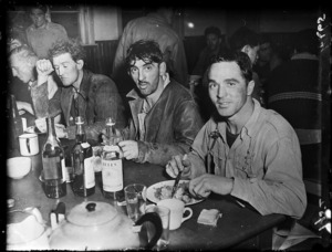 Men seated at a table eating a meal, Rimutaka Tunnel