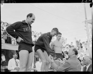 D Hawkins on victory stand, 1950 British Empire Games, Auckland