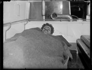 Injured worker covered in blankets