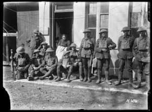 New Zealand troops with an old lady who is the only civilian left in the village and stubbornly refuses to leave despite the shells, Mailly