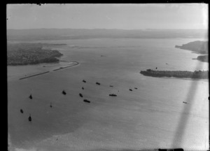 View to Westhaven Marina and Saint Mary's Bay to Northcote Peninsula with a flotilla of ships on Auckland Harbour