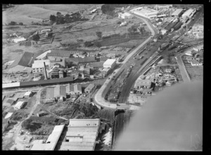 View of the Australian Glass Company with Great South Road and Penrose Railway Station with yards, Auckland