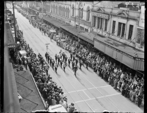 Brass band marching in Willis Street, Wellington