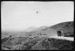 Hilly landscape showing military trucks, north of Larissa, near Ellason, Greece, during World War II - Photograph taken by Ian Macphail
