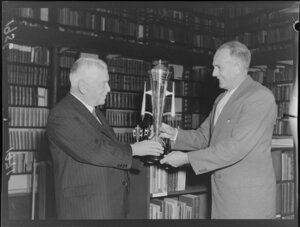 Labour Party leader Walter Nash handing a trophy to Major P G Monk, president of the Hutt Valley Cricket Association