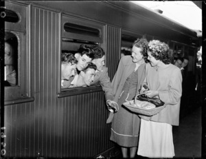 Women talking to soldiers on a train at Wellington Railway Station