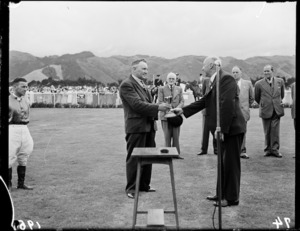 Presentation of Wellington Cup to owner of winning horse, Trentham Racecourse
