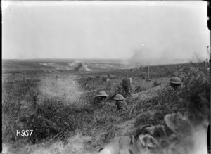 New Zealand troops in shell hole positions during shelling by German artillery in France, World War I
