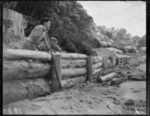 Mr E Pilcher and Mr L Coffey building a sand stop at Worser Bay, Wellington