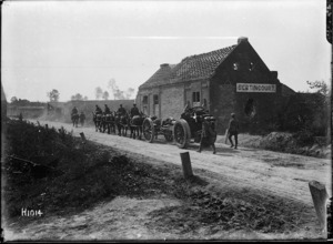 A 60 pounder gun going forward through the captured village of Bertincourt, France, during World War I