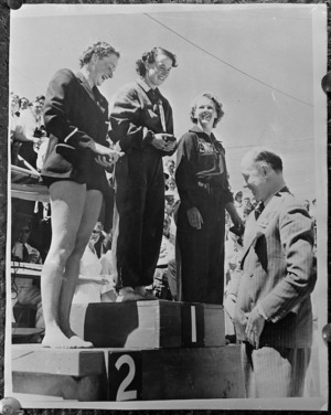 Mr Porritt presenting trophies to winning athletes at British Empire Games, Auckland