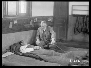 Sir Thomas MacKenzie at a soldier's bedside during World War I, France