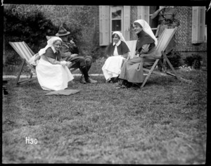 Matron Price at a garden party in the grounds of the New Zealand Stationary Hospital, France