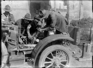 Soldiers repairing a car at the New Zealand Motor Transport Company workshops, Bonnieres, World War I