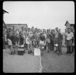 Prisoners of war at Camp 57, Gruppignano, Italy, lining up for food - Photograph taken by Lee Hill