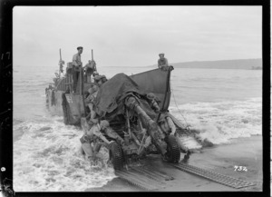New Zealand soldiers unloading a Bofors gun from a barge