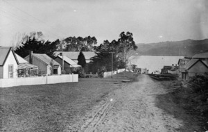 View of Rawene showing dirt road and houses with picket fences