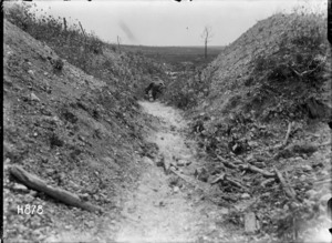 A runner moving through a front line trench in World War I