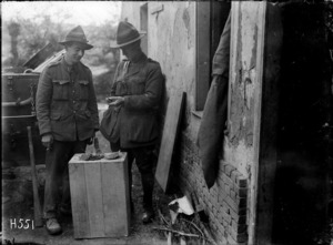 New Zealanders examine shrapnel from a German shell hitting an army building, France