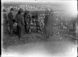 New Zealand soldiers looking at the official photographer's camera in France, World War I