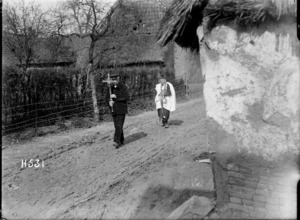 A village priest on his way to attend badly wounded civilians, France