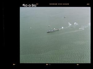 Royal Canadian Navy ships with the naval flotilla; gun firing salute