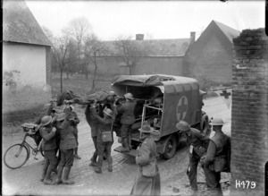 Wounded World War I New Zealand soldiers being placed in an ambulance, France