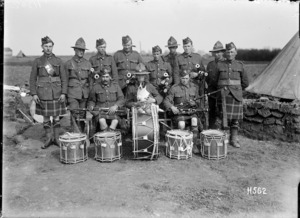 An Auckland Regimental pipe band with canine mascot, France