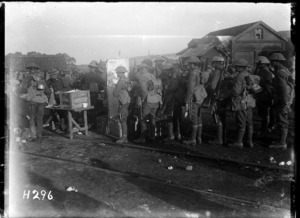 New Zealand troops leaving the line receive tea, cigarettes and biscuits distributed by the YMCA