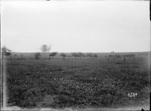 A German shell bursts over a French orchard, World War I