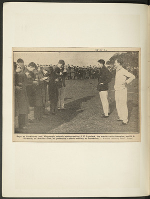 Newspaper photograph of Jack Lovelock and D A Rickards being photographed by schoolboys at Crewkerne School