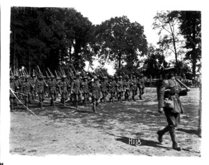 Marching New Zealand troops inspected by Brigadier General Hart