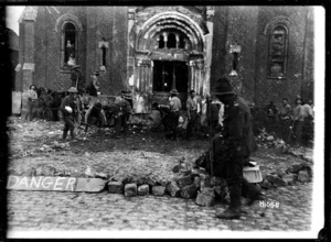 New Zealand Pioneers filling in a mine crater outside a church, World War I
