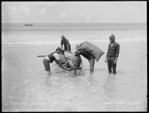 Shipping Kauri gum from beach, North Cape