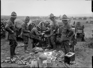 New Zealand machine gunners fitting machine gun belts with cartridges, France