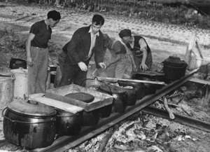 Men cooking outdoors, probably at the centenary celebrations for Rangiatea Church in Otaki