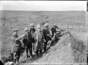 Visiting New Zealand journalists on the battlefield at Haplincourt, World War I