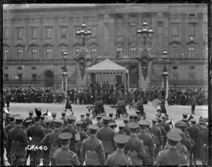 A Highland pipe band marching past Buckingham Palace after World War I