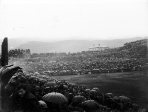 Crowd of rugby spectators in the rain at Athletic Park, Wellington