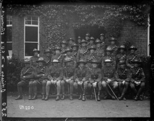 New Zealand officers and NCOs outside a headquarters building in England