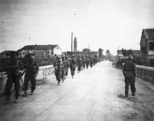 Pritchard, G E, fl 1945 : Members of 8th Platoon, B Company, 25th Battalion, marching near Massa Lombarda, Italy