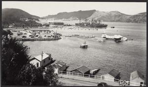 Solent flying boat towed to pontoon dock, Evans Bay