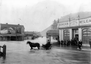 Flooding outside the shop of Duncan McLean, Greymouth