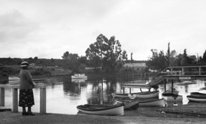 Catherine Maud Kent alongside rowboats, Lake Taupo