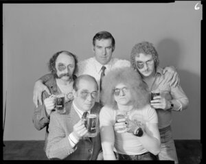 Colin Meads with men drinking beer with black eyes