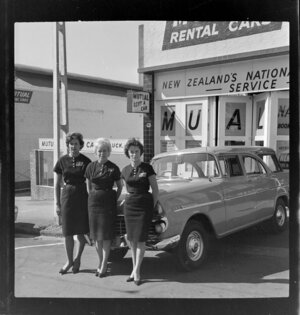 Three staff employees standing outside Mutual rental cars Ltd, Auckland