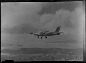Rallye aircraft flying over Auckland