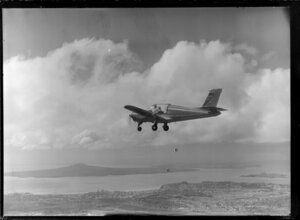 Rallye aircraft flying over Auckland