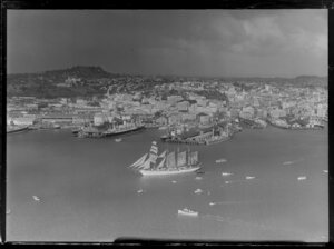 Auckland waterfront and wharves, with sailing ship Esmeralda on the harbour